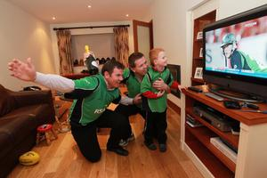 Brothers of Ireland cricketer Kevin O'Brien, Conor and Gerard (right) and his nephew Sean watch his match against England in the ICC Cricket World Cup, at Gerard's home in Terenure, Dublin
