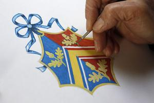 LONDON, ENGLAND - APRIL 18:  Herald Painter, Robert Parsons, sketches the new Coat of Arms for Catherine Middleton's family at the College of Arms in London on April 18, 2011 in London England.  Catherine Middleton will use this Coat of Arms until her April 29th royal wedding to Britain's Prince William, when it will be merged with his Coat of Arms. (Photo by Suzanne Plunkett - WPA Pool / Getty Images)