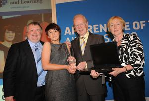 Caption (embedded) L-R : Awards compere Stephen Nolan, Stacey Sharples, Employment and Learning Minister, Sir Reg Empey and Helen Bready from Award sponsor City & Guilds.