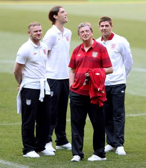 DONETSK, UKRAINE - JUNE 18:  (L to R) England's Wayne Rooney, Andy Carroll, Roy Hodgson and Steven Gerrard inspect the pitch during a UEFA EURO 2012 training session at the Donbass Arena on June 18, 2012 in Donetsk, Ukraine.