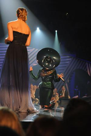 BELFAST, NORTHERN IRELAND - NOVEMBER 06:  Model Bar Rafaeli (L) and Lady Gaga perform onstage during the MTV Europe Music Awards 2010 live show at at the Odyssey Arena on November 6, 2011 in Belfast, Northern Ireland.  (Photo by Dave Benett/Getty Images)