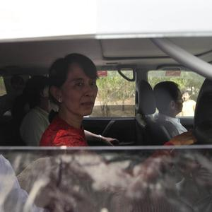 Aung San Suu Kyi arrives at a polling station in the village of Wah Thin Kha, Burma (AP)