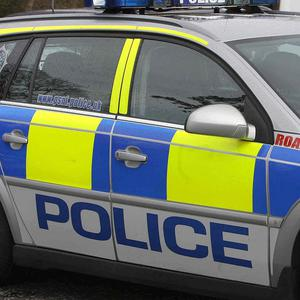 Police are appealing for witnesses after a petrol bomb was thrown at a house in Antrim