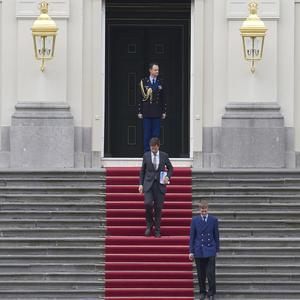 Dutch prime minister Mark Rutte leaving the royal palace after giving his resignation to Queen Beatrix (AP)