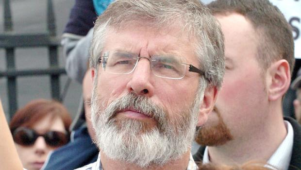 Gerry Adams with protesters outside Belfast City Hall