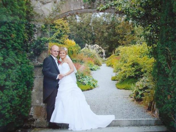 """Pictured after their recent wedding at Moneyslane Free Presbyterian Church are Mr Mark Herron, son of Mr & Mrs David & Noleen Herron, Moneyslane Road, Ballyward and Miss Glynis Wilson daughter of Mr & Mrs Cecil & Elsie Wilson, Katesbridge Road, Dromara. <p><b>To send us your Wedding Pics <a  href=""""http://www.belfasttelegraph.co.uk/usersubmission/the-belfast-telegraph-wants-to-hear-from-you-13927437.html"""" title=""""Click here to send your pics to Belfast Telegraph"""">Click here</a> </a></p></b>"""