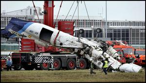 The mangled wreckage of the Manx2.com aircraft is removed