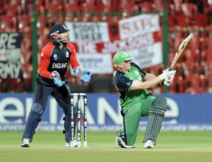 Ireland's Kevin O'Brien hits the ball for 6 runs during the ICC Cricket World Cup match at the at M Chinnaswamy Stadium, Bangalore, India