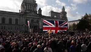 The parade makes its way past Belfast City Hall