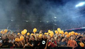 Fans go mad as U2 perform onstage on the first night of their 360 tour held at Camp Nou on June 30, 2009 in Barcelona, Spain.