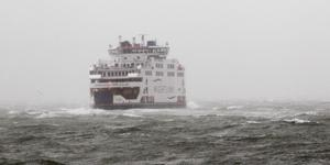 A ferry sets sail as it crosses from Portsmouth to Fishbourne on the Isle of Wight as fierce storms battered Britain today, with heavy rain and winds gusting up to 85mph