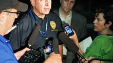 Aurora Police Chief Dan Oates talks to reporters at the Aurora Mall where 14 people were shot dead at the Batman film screening (AP)