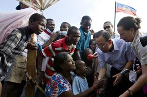 In this photo provided by the U.N., United Nations Secretary General Ban Ki Moon speaks with displaced Haitians during his trip to Port au Prince, Haiti on Sunday Jan. 17, 2010.