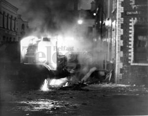 Riots : Belfast. August 1969.  Flames and smoke pour from a lorry which was set on fire in Hooker Street, Belfast.  5/8/1969.