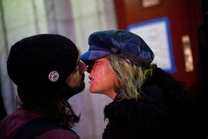 NEW YORK, NY - OCTOBER 28:  Mark Clemente and Mary McSweeney kiss before going back inside Seward Park High School, which is doubling as a hurricane evacuation center, prior to the arrival of Hurricane Sandy, on October 28, 2012 in New York City. Sandy, which has already claimed over 50 lives in the Caribbean, is predicted to bring heavy winds and floodwaters as the mid-atlantic region prepares for the damage.  (Photo by Andrew Burton/Getty Images)