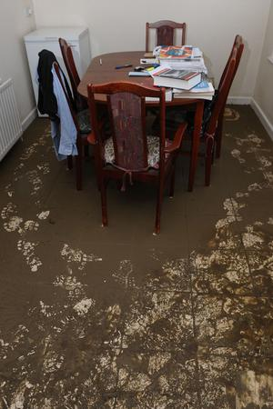 Sand covers the floor of a house after the flooding at Bealaghmor
