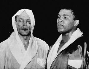 18/06/1963: Cassius Clay (right) and Henry Cooper after their fight at Wembley, London.
