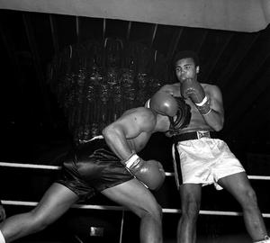 11/10/1971: American Alonso Johnson ducks away from Muhammad Ali, during exhibition bouts for ladies night at the London Hilton.