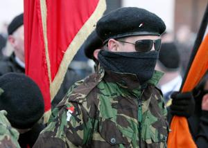 Masked INLA members during a republican parade in Londonderry
