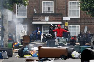 LONDON, ENGLAND - AUGUST 08:  Rioters organise the construction of barricades in Goulton Road in Hackney on August 8, 2011 in London, England. Pockets of rioting and looting continues to take place in various boroughs of London this evening, as well as in Birmingham, prompted by the initial rioting in Tottenham and then in Brixton on Sunday night. It has been announced that the Prime Minister David Cameron and his family are due to return home from their summer holiday in Tuscany, Italy to respond to the rioting. Disturbances broke out late on Saturday night in Tottenham and the surrounding area after the killing of Mark Duggan, 29 and a father-of-four, by armed police in an attempted arrest on August 4.  (Photo by Dan Istitene/Getty Images)
