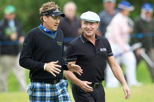 Famous Irish dancer Michael Flatley chats with Ian Poulter of England during the first round of The JP McManus Invitational Pro-Am event at the Adare Manor Hotel and Golf Resort on July 5, 2010 in Limerick