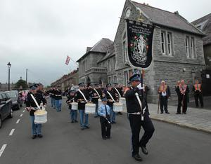 Bessbrook True Blues  parade through the strreets of Bessbrook before heading to Co Armagh 12th celebration in Killylea. 12 July 2011