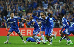 MUNICH, GERMANY - MAY 19:  (L-R) Gary Cahill, Florent Malouda, Fernando Torres and Jose Bosingwa of Chelsea celebrate after Didier Drogba scored the winning penalty during UEFA Champions League Final between FC Bayern Muenchen and Chelsea at the Fussball Arena München on May 19, 2012 in Munich, Germany.  (Photo by Mike Hewitt/Getty Images)