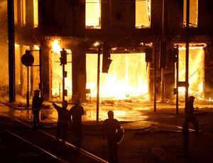 A property on fire near Reeves Corner, Croydon,  as rioters were rampaging across Britain's capital again tonight. PRESS ASSOCIATION Photo. Picture date: Monday August 8, 2011. See PA story POLICE Shooting. Photo credit should read: Dominic Lipinski/PA Wire