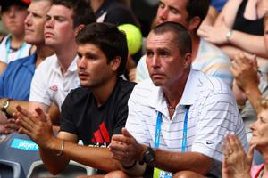 Andy Murray's coaches Danny Valverdu (L) and Ivan Lendl watch his first round match against Ryan Harrison of the USA during day two of the 2012 Australian Open