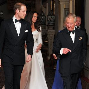 The Prince of Wales walks with Prince William ready for the evening celebrations following the wedding