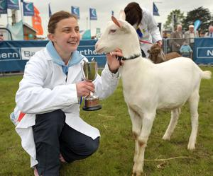 Karren Wells from Markethill celebrates with her goat Molly after winning her class at the Balmoral show