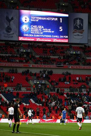 LONDON, ENGLAND - APRIL 15:  A view of empty seats as the electronic board shows the score during the FA Cup with Budweiser Semi Final match between Tottenham Hotspur and Chelsea at Wembley Stadium on April 15, 2012 in London, England.  (Photo by Michael Steele/Getty Images)