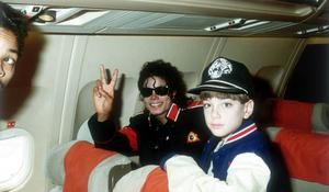 Michael Jackson with 10 year old Jimmy Suchcraft on the tour plane on 11th of July 1988.