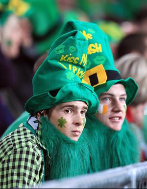 Ireland fans in the stands during the IRB Rugby World Cup match at the Otago Stadium, Dunedin, New Zealand. PRESS ASSOCIATION Photo. Picture date: Sunday October 2, 2011. See PA story RUGBYU Ireland. Photo credit should read: Lynne Cameron/PA Wire. RESTRICTIONS Use subject to restrictions. Editorial reporting purposes only; no images to be used to simulate a moving image. Commercial including Book use only with prior written approval. Call +44 (0) 1158 447447 or see www.pressassociation.com/images/restrictions.