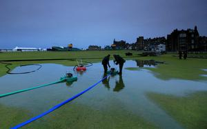 Course workers clear water at The Open. July 2010