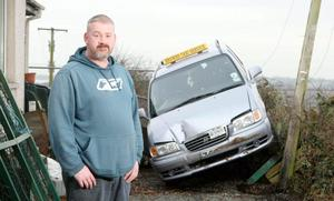Caption: ©Matt Mackey/Presseye.com - Press Eye Ltd - Northern Ireland 26th January 2010.Jonathan Brown pictured beside his taxi at his home on the Crumlin Road close to Ballinderry.