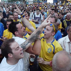 England and Sweden fans mingle with each other, singing football songs, at the fanzone in Kiev, Ukraine