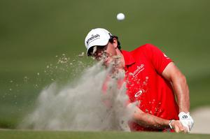 KIAWAH ISLAND, SC - AUGUST 12: Rory McIlroy of Northern Ireland hits out of the sand on the tenth hole during the Final Round of the 94th PGA Championship at the Ocean Course on August 12, 2012 in Kiawah Island, South Carolina.  (Photo by Jonathan Ferrey/Getty Images)