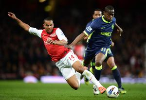 LONDON, ENGLAND - APRIL 16: Theo Walcott of Arsenal is tackled by Maynor Figueroa of Wigan during the Barclays Premier League match between Arsenal and Wigan Athletic at Emirates Stadium on April 16, 2012 in London, England.  (Photo by Laurence Griffiths/Getty Images)