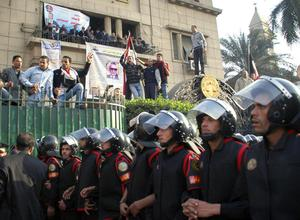 Egyptian anti-riot police block the way leading to a journalists syndicate in downtown Cairo, Egypt, Wednesday, Jan. 26, 2011. A small gathering of Egyptian anti-government activists tried to stage a second day of protests in Cairo Wednesday in defiance of a ban on any gatherings, but police quickly moved in and used force to disperse the group. (AP Photo/Mohammed Abu Zaid)
