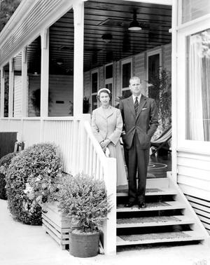 12/03/1954  Queen Elizabeth II and the Duke of Edinburgh on the steps of the veranda at O'Shannassy Chalet, Warburton, where they enjoyed a weekend of privacy during their Australian tour. PRESS ASSOCIATION Photo.