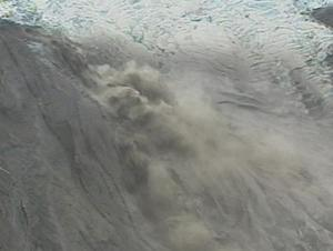 Melting ice spewing from the crater of the volcano under the Eyjafjallajokull glacier in Iceland