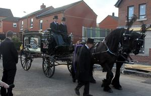 The cortege of snooker legend Alex Higgins makes a poignant journey through the centre of Belfast on its way to St Anne's Cathedral. August 2010