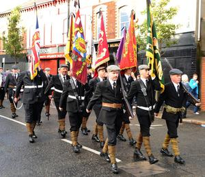 Orangemen and bandsmen in traditional dress parade through Belfast to mark the 100th anniversary of the signing of the Ulster Covenant