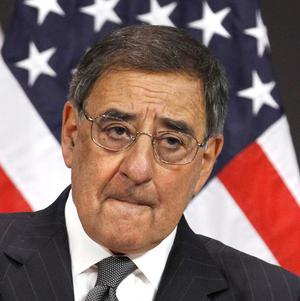 Defence secretary Leon Panetta listens to a question about photographs of soldiers posing with dead insurgents during a press conference (AP)