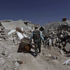 The rubble of houses destroyed from Syrian government forces shelling in Azaz, on the outskirts of Aleppo (AP)