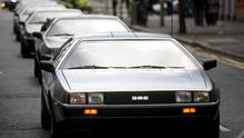 The cavalcade of DeLoreans snakes its way yesterday from Belfast's Europa Hotel to Carrickfergus Castle
