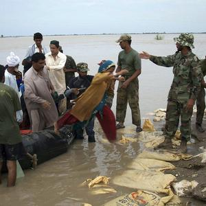Pakistan army troops rescue stranded villagers from the floods (AP)
