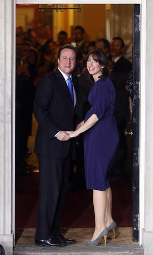Britain's new Prime Minister David Cameron and his wife, Samantha, on the doorstep of 10 Downing Street