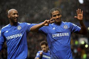Florent Malouda (right) of Chelsea celebrates with teammate Nicolas Anelka after scoring his team's second goal during the Barclays Premier League match between Chelsea and Sunderland at Stamford Bridge